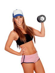 Attractive woman with dumbbells training