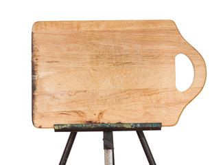 Wooden chopping board on metal easel