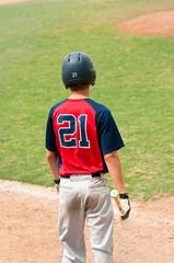 Teen player at bat
