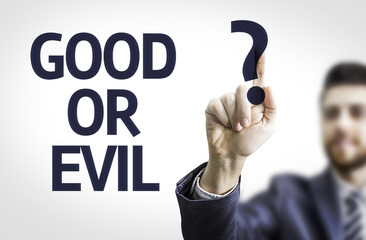 Business man pointing the text: Good or Evil?