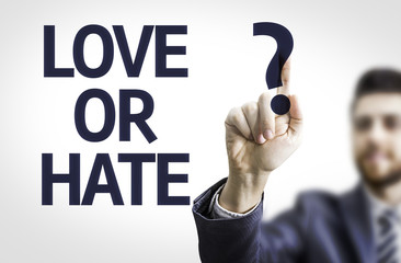 Business man pointing the text: Love or Hate?