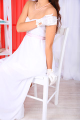 Beautiful bride in wedding  dress and gloves, close-up,