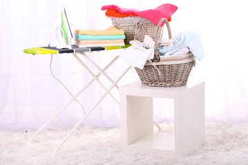Basket with laundry and ironing board