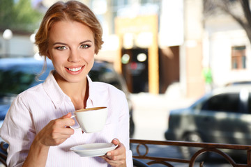 Beautiful young woman sitting in cafe