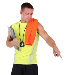 Handsome young sportsman holding clipboard and towel isolated