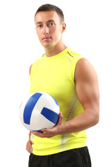 Handsome young sportsman holding ball isolated on white