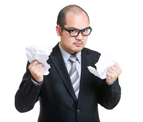 Angry businessman tear paper