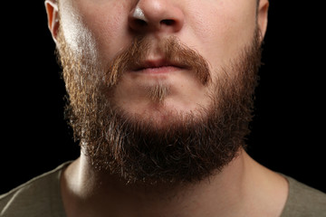 Closeup of long beard and mustache man on dark background