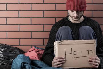 A homeless man need money