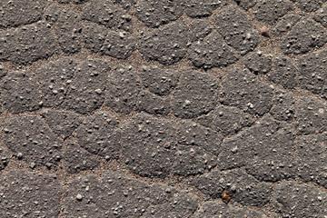 Cracked asphalt.