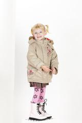 little girl wearing a coat