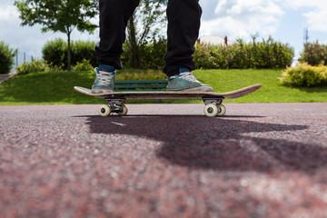 Close up legs on skateboard