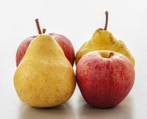 ripe pear and apple on a white background close-up