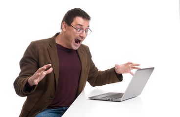 attractive young man screaming on his laptop