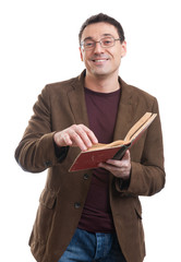 Casual man smile and reading a book