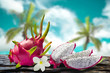 Dragon fruit and flower with  coconut and sky blur on background