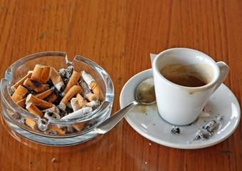 ashtray chock full of cigarette butts