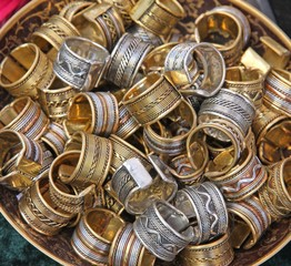 pile ethnic rings sold at local market
