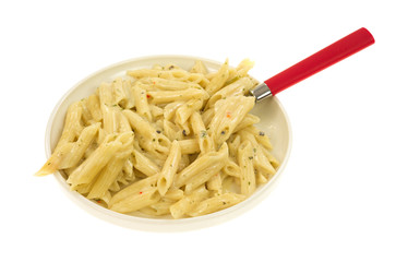 Cooked pasta in cream sauce with a spoon