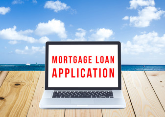 Mortgage loan application on Laptop computer screen with seascap