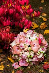 wedding rings on autumn bridal bouquet