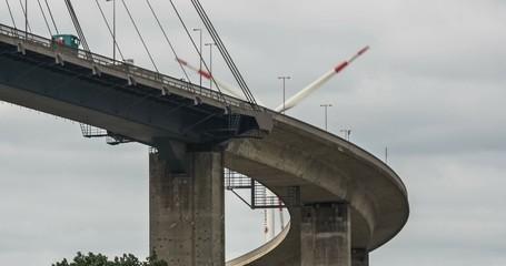 Traffic on Bridge, with Wind Turbine in Background