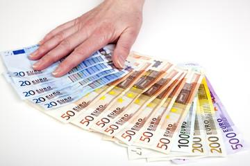 Hand fans out euro bills