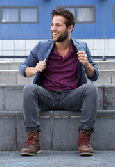 Cool guy sitting outside on steps
