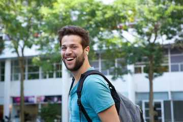 Young man smiling with backpack