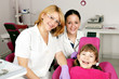 happy little girl patient with dentist and nurse