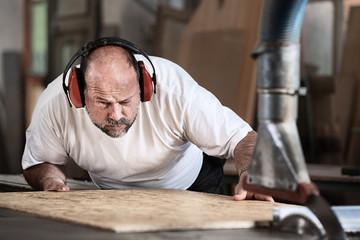Carpenter at the Circular Sawing Machine