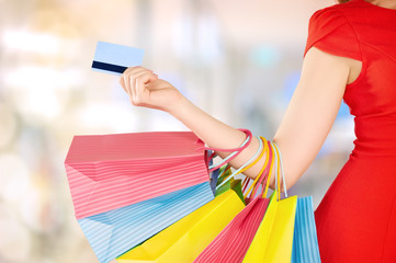 happy woman on shopping with bags, credit cards