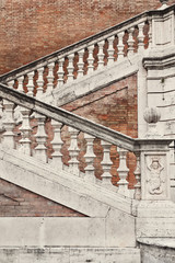 Staircase with a balustrade in old house, Rome, Italy