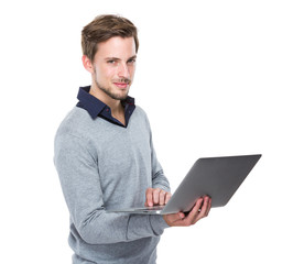 Caucasian man use of notebook computer