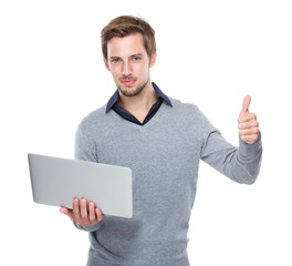 Caucasian man hold with laptop and thumb up