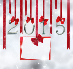 2015 number ornaments and greeting card hanging on red ribbons
