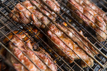 pieces meat char-grilled over flame