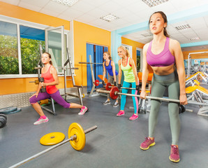 Group of girls deadlift in fitness club