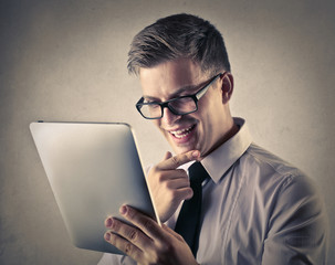 businessman who is looking something interesting in the tablet