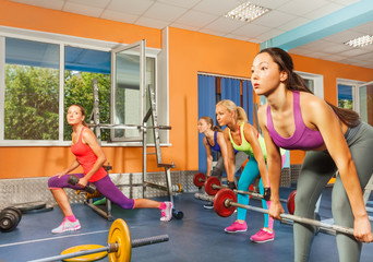 Group weight lifting class in fitness club