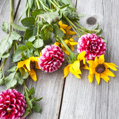 Freshly cut asters and rudbeckia on wooden background