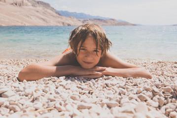 relaxed boy on the beach