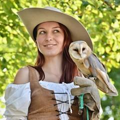 Sexy falconer holding barn owl
