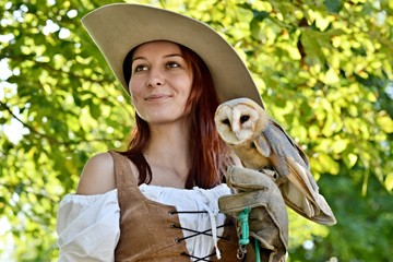 falconer holding barn owl