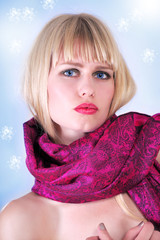 Winter fashion girl in cozy woolen scarf