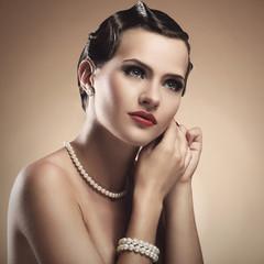 Vintage. Beautiful woman during preparation