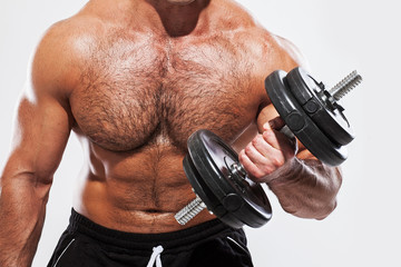 Fitness. Man with dumbbell