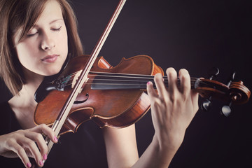 Young and beautiful woman with a violin