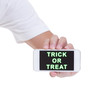 Leinwanddruck Bild - Trick or treat on mobile phone