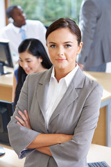 Portrait Of Female Manager In Busy Office